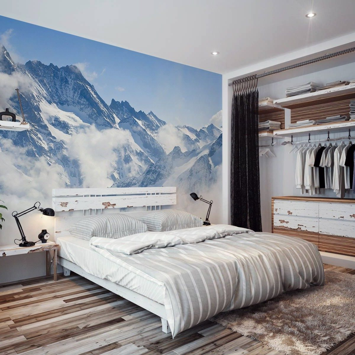 A bedroom with a mountain in the background